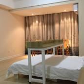 青島海邊萬達套一商務家庭均宜品質公寓(分店)