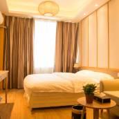 青島樂晶度假公寓